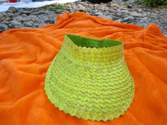 Green hat orange towel