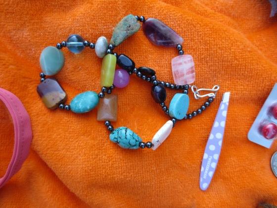 Necklace, tweezer, advil
