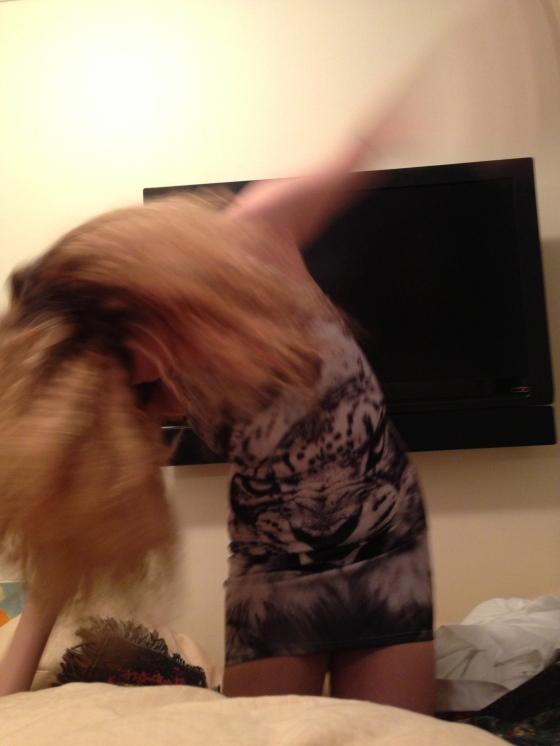 blonde hair shaking
